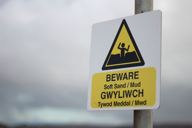 A close-up of the warning sign