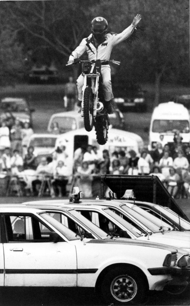 Eddie Kidd thrills and audience of 3000 people at Barry's Romily Park after jumping 12 taxis on his motorbike! July 1990