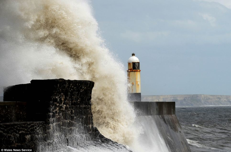 Porthcawl lighthouse in South Wales was dwarfed by waves as the wind and rain continue to affect the British summer