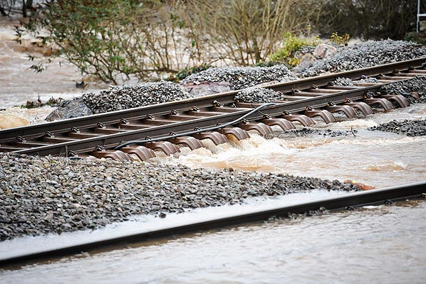 damage caused to the railway line at Cowley Bridge, near Exeter, Devon