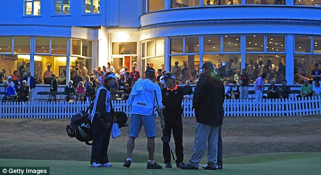 In talks: Langer and Wiebe played into the night, helped by the clubhouse lights, before calling it a day
