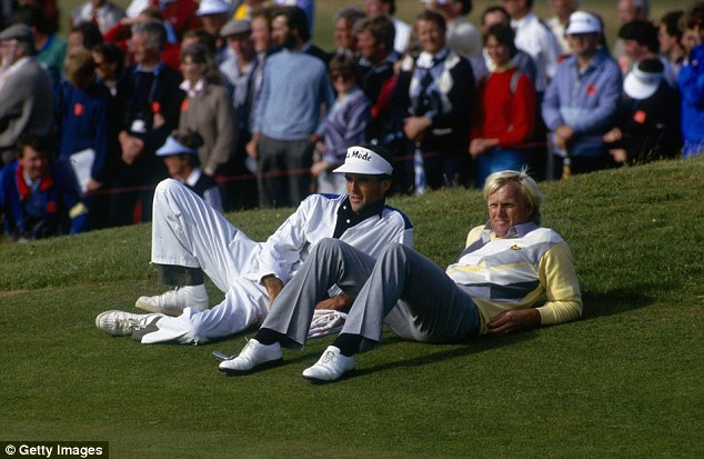 Nervous wait: Norman and his caddy take a break during the final round of the 1986 tournament in Turnberry