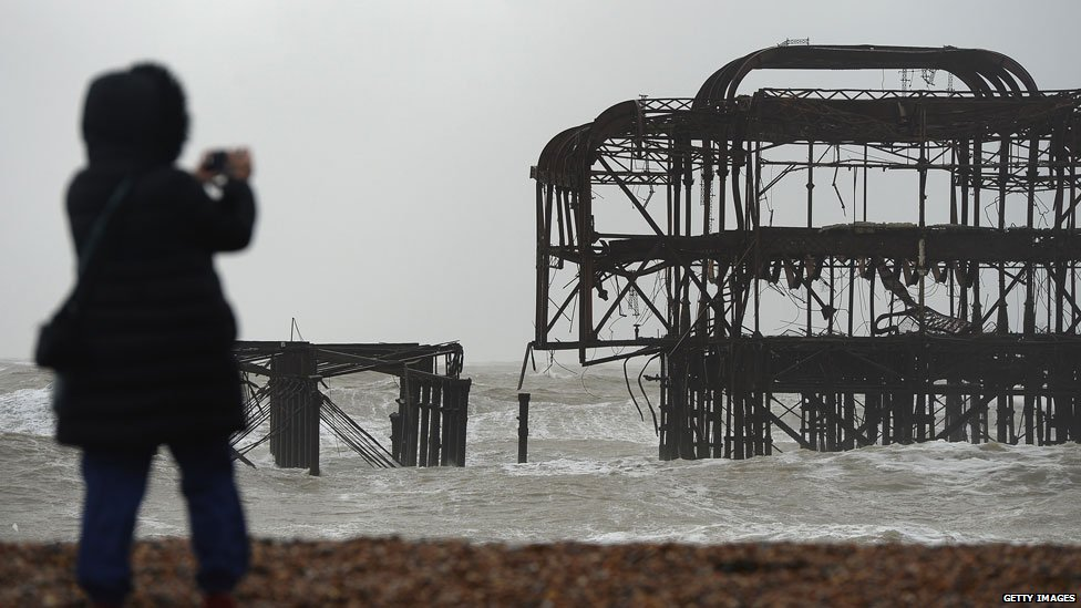 Brighton's dilapidated West Pier from which a large section has been washed away