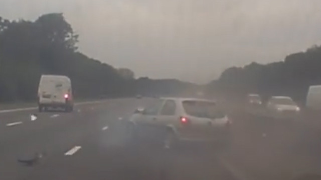 Smoke can be seen coming from the car's bonnet as it grinds to a halt on the motorway