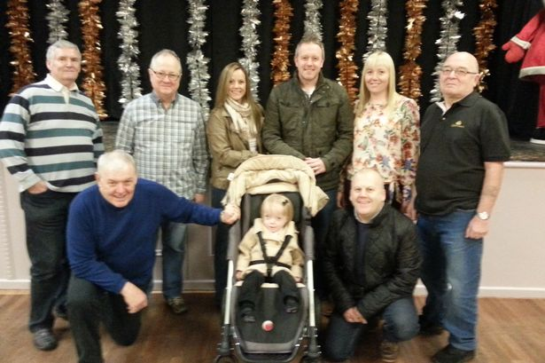 Trealaw Jolly Boys, from left, Selwyn Fussell, Graham Waters, Robert Jones, David Westcott and Billy Anthony, pictured with Kate and Lee Morgans (centre), Lee's sister Kelly James and Ellie