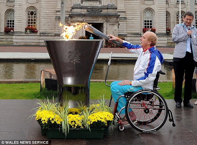 Mr Richardson lighting the Olympic flame in Cardiff. The Paralympian is now offering his services as a motivational speaker to help pay for an £1,000 electric wheelchair