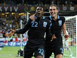 Dream team: Welbeck and Carroll celebrate England's winner.