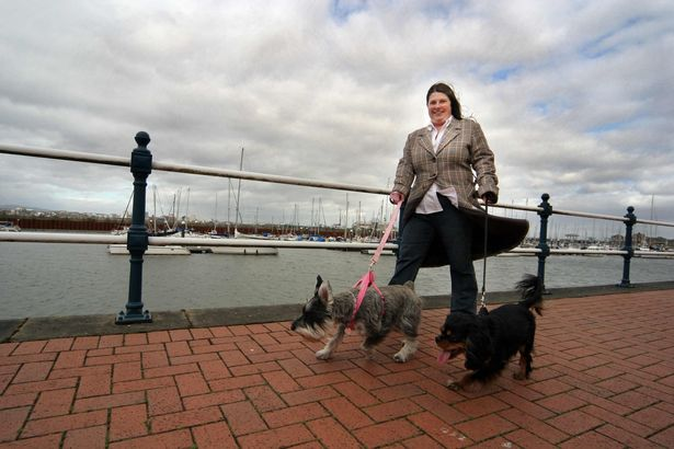 Sarah Johansen out walking with her two dogs at Penarth Marina in 2009