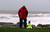 A man and his dog stand watching as waves roll in at the beach in Porthcawl, south Wales on October 27, 2013 ahead of the arrival of a predicted storm. Britain was braced on October 27 for its worst storm in a decade, with heavy rain and winds of more than 80 miles (130 kilometres) an hour set to batter the south of the country.    GEOFF CADDICK/AFP/Getty Images