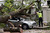 A contractor works on clearing the debris after a tree fell on car during a storm in London on October 28, 2013.   AFP PHOTO / DANIEL SORABJI/AFP/Getty Images