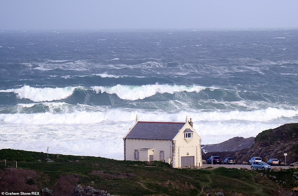 Northern Ireland is covered by a yellow rain warning, with the flooding of some homes and businesses 'likely' (pictured: Newquay)