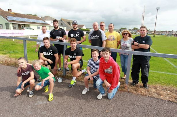 Ospreys players help paint the ground at Porthcawl RFC