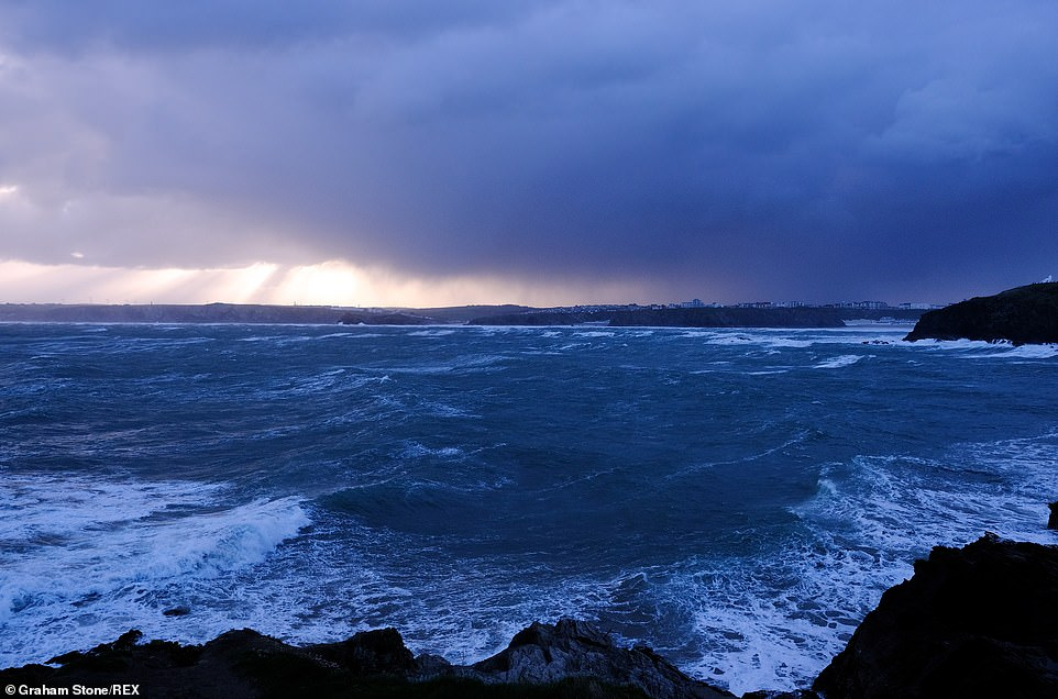 Many areas will see wet and windy conditions on Saturday, although Scotland and South East England are expected to see better weather (pictured: Towan Head, Newquay)