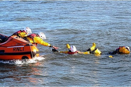 prepared   The Inshore Lifeboat joins the RNLI Mumbles Lifeboat during a training exercise in Swansea Bay.