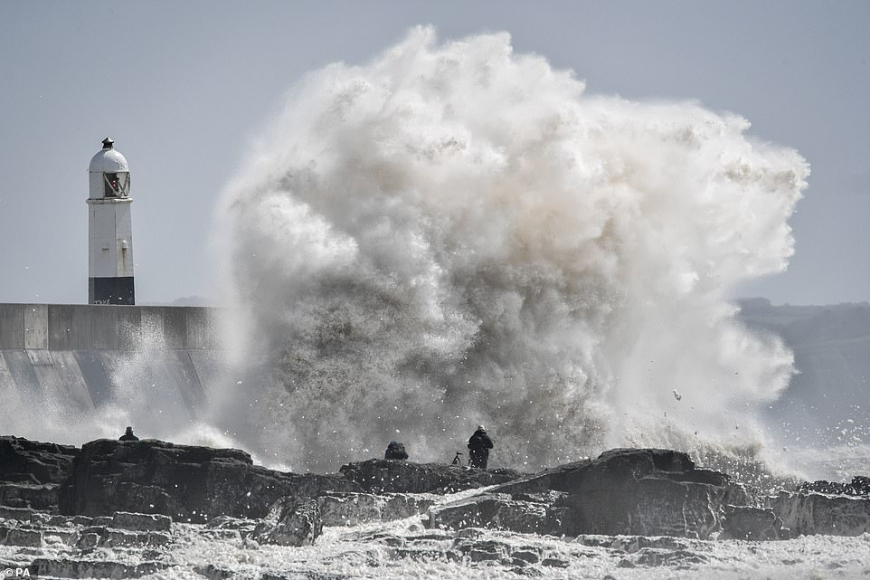 The Met Office's Simon Partridge told MailOnline that Northern Ireland and western Wales 'really bore the brunt of the rain so far' (pictured: Porthcawl, Wales)